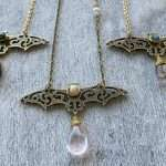 Crystal bat talisman with rose quartz